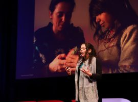 Image of Yael Warshel delivering TEDx talk